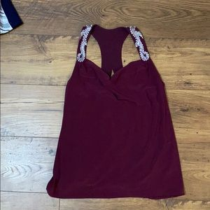Burgundy silk top with pearl embellishment